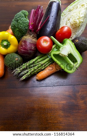 Fresh vegetables on kitchen table - stock photo