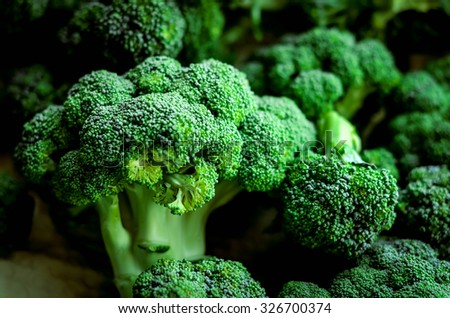fresh vegetables on the cutting board. broccoli  - stock photo
