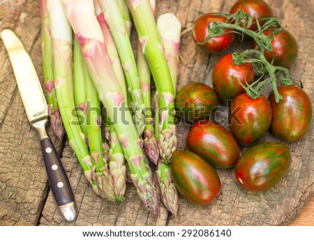 Fresh vegetables on the table - asparagus and tomatoes
