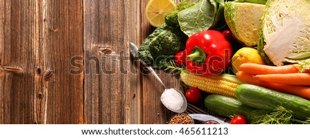Fresh vegetables on wooden background with space for text