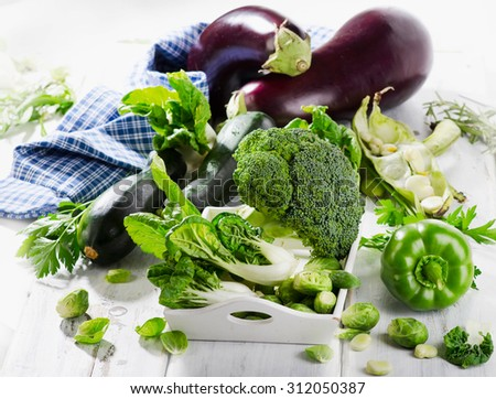 Fresh vegetables on wooden table. Healthy food concept. Selective focus