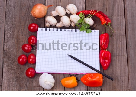 Fresh vegetables over wooden background paper for notes with copy space