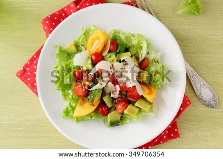 fresh vegetables salad on plate, food top view