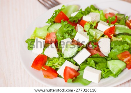 fresh vegetables salad with cheese - stock photo