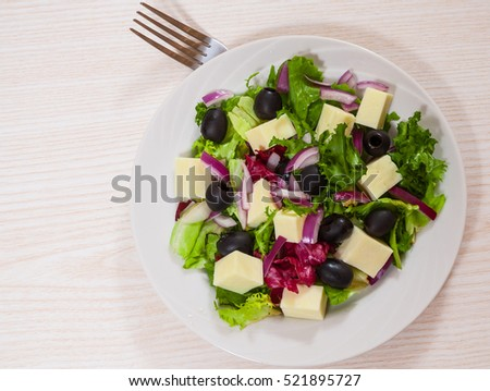 fresh vegetables salad with cheese and olive