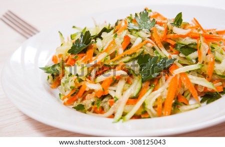 fresh vegetables salad with cucumber and carrot