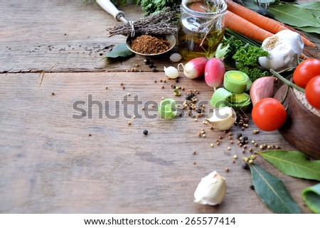 fresh vegetables, spices, aromatic herbs and olive oil - stock photo