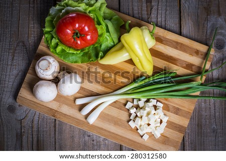 Fresh vegetables with cottage cheese on wooden table - stock photo
