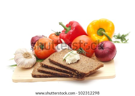 fresh vegetables with dark bread isolated on white background