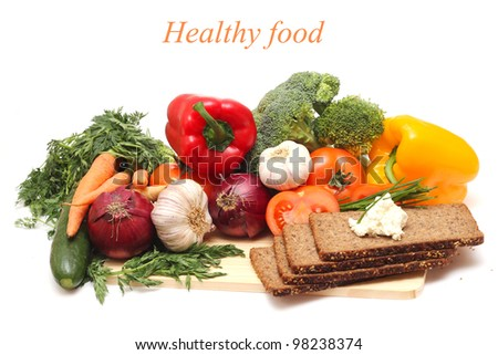 fresh vegetables with dark bread isolated on white background - stock photo