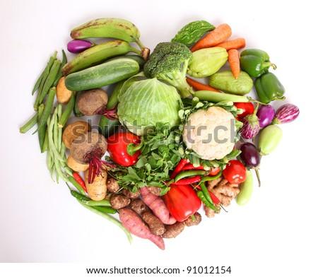 fresh vegetables with heartin shape on white background. - stock photo