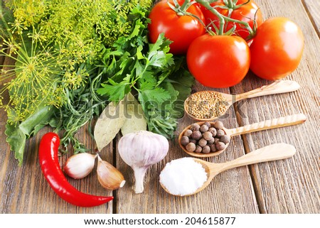 Fresh vegetables with herbs and spices on table, close-up