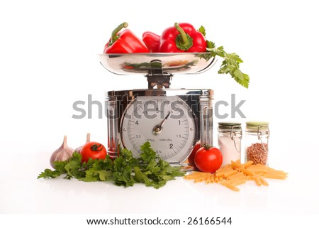 Fresh vegetables with kitchen scales - still life
