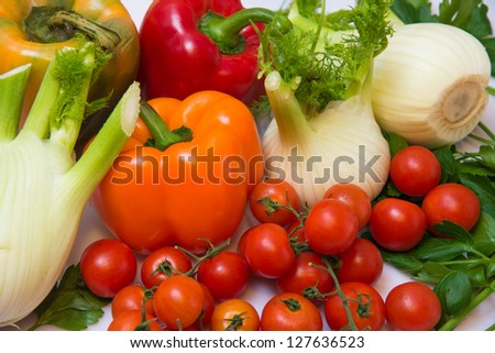 fresh vegetables with peppers, tomatoes and parsley