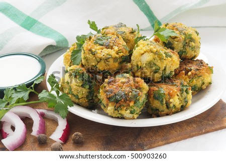 fresh vegetarian falafel balls on a palte with sauce
