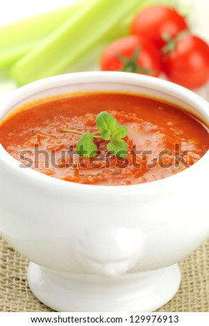 Fresh vegetarian homemade pureed tomato and celery soup