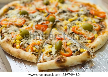 Fresh Vegetarian Pizza with green Olive red Pepper Mushroom Sweetcorn - stock photo