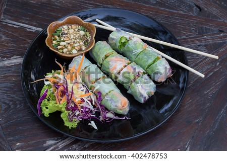 Fresh Vietnamese spring rolls on a plate with salad