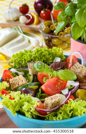 Fresh vitaminic green salad with bread cubes and tasty selection of vegetables.
