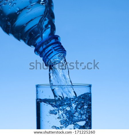 Fresh water - filling a glass with liquid - stock photo