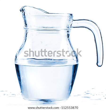 fresh water in a glass pitcher - stock photo