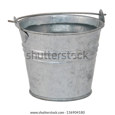 Fresh water in a miniature metal bucket, isolated on a white background - stock photo