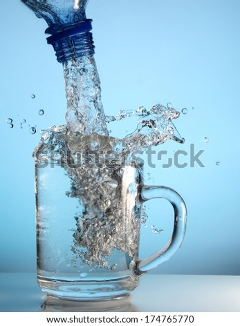 fresh water is poured into a clean glass - stock photo