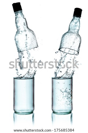 Fresh water splashing out of bottle, isolated on white background