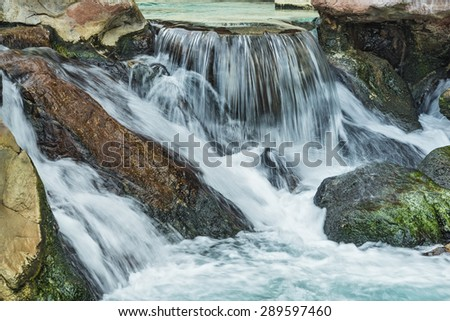 Fresh waterfall This water motion cascade connects you with natural resources - stock photo
