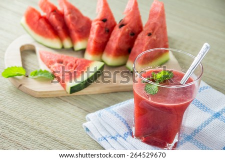 Fresh watermelon and glass of watermelon juice,selective focus on mint - stock photo