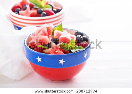 Fresh watermelon cut in star shape with blueberries on white background - stock photo