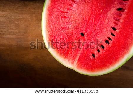 Fresh watermelon wooden background - stock photo