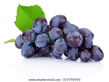 Fresh wet blue grapes with green leaf isolated on white background - stock photo