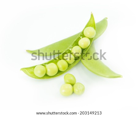 Fresh wet green peas isolated on white background