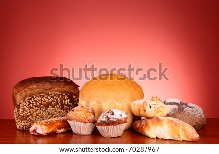 Fresh wheat bread on red background