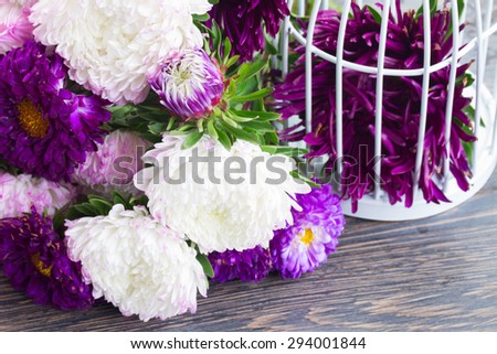 fresh white and violet aster flowers on table  - stock photo