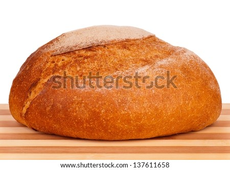 Fresh white bread on a cutting board on white background - stock photo