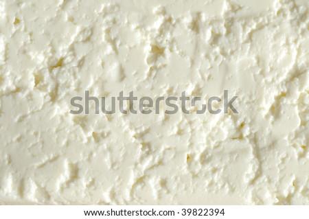 Fresh white cheese as a background - stock photo