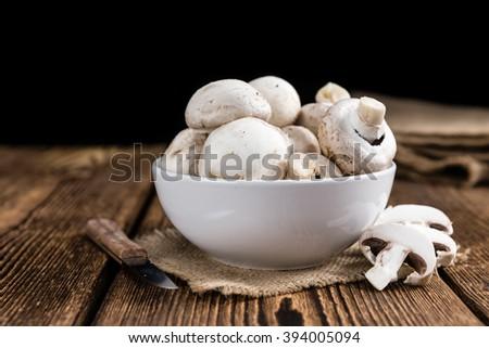 Fresh white Mushrooms on vintage wooden background  (selective focus) - stock photo