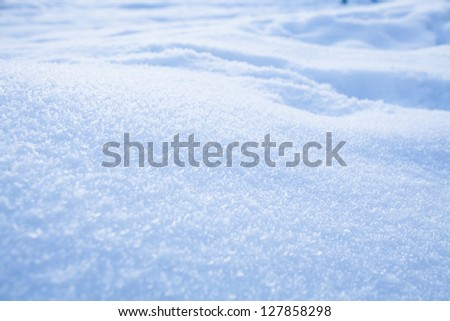 Fresh white powder snow background from outdoors on winter day - stock photo