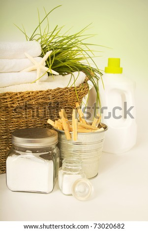 Fresh white towels with liquid soap, powder and clothespins for the laundry day - stock photo
