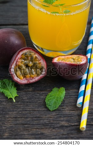 Fresh whole and cut passion fruits and refreshing juice from above - stock photo