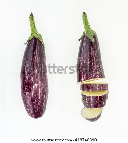 Fresh whole and sliced purple eggplant , isolated on white background - stock photo