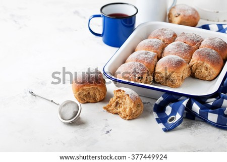Fresh whole grain sweet buns with raisins, selective focus - stock photo