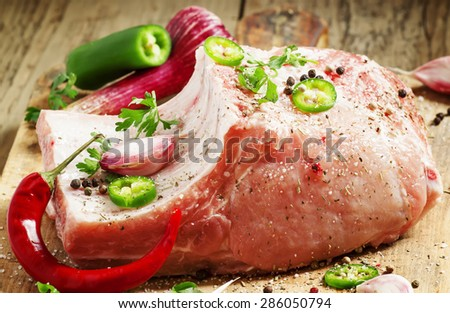 Fresh whole pork loin chops with spices for the marinade, selective focus - stock photo