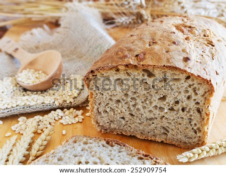 Fresh  Whole Wheat Bread on wooden table - stock photo