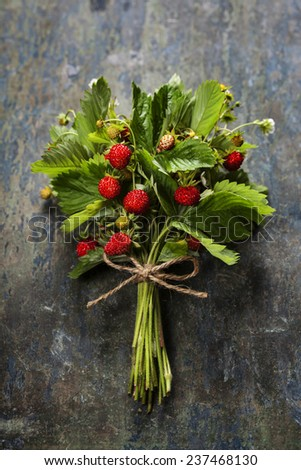 fresh Wild strawberries on wooden background  - summer, healthy or vegetarian eating concept