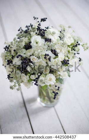 Fresh winter bouquet on white wooden background.Selective focus