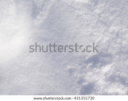 Fresh Winter Snow Texture Background - Top view texture of white fluffy snow crystals on the cold winter ground, Christmas background nature photo. - stock photo