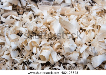 Fresh wooden shavings on a joiner's bench. Traditional joiner's work.